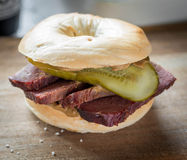 A salt beef bagel with gherkin and mustard Royalty Free Stock Photo