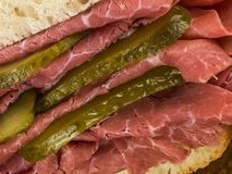 Salt Beef or Pastrami With Gherkins in a Ciabatta Bread Roll or Stock Images