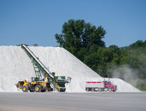 Salt being moved into Pile Royalty Free Stock Photo