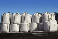 Salt big bags sacks stacked rows for iced roads Royalty Free Stock Photography