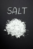 Salt on black background Royalty Free Stock Photos