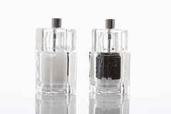 Salt and black pepper in spice grinder Stock Images