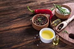 Salt, Black Seed Pepper, Branch Of Rosemary, Red Hot Chili Stock Photo