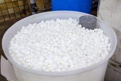 Salt blocks for softener. An barrel of salt blocks for the softener Stock Image