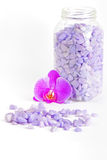 Salt in the bottle and orchid flower Royalty Free Stock Photos