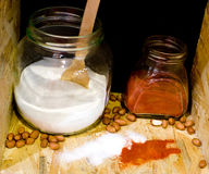 Salt and cayenne pepper in jars Royalty Free Stock Images