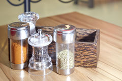 Salt cayenne pepper Oregano and black pepper on table stock images