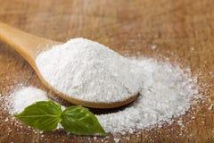 Salt. Coarse grained sea salt on wood. En background royalty free stock photo