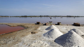 Salt collecting industry. In Senegal. Lake Retba or Pink Lake stock photography
