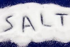 Salt concept. On dark blue background Royalty Free Stock Image