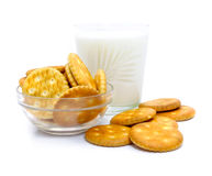 Salt crackers and milk in glass Stock Photo
