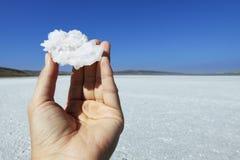 salt crystal hand Arkivfoto