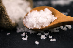 Salt crystals on black stone plate background , selective focus Royalty Free Stock Photography
