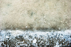 Salt crystals in evaporation pond close up Royalty Free Stock Images