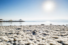 Salt crystals on the shores of the dead sea at dawn Royalty Free Stock Photos