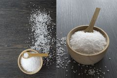 Salt crystals in a wooden bowl with spoon Stock Images
