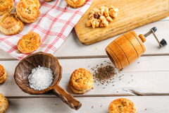Salt and cumin snacks or pastries with grinder and wooden spoon on white background, product photography for bakery shop, baking Royalty Free Stock Photos