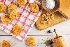 Salt and cumin snacks or pastries with grinder and wooden spoon on white background, product photography for bakery shop, baking Stock Photo