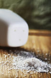 Salt on a cutting board close-up vertical Royalty Free Stock Photo