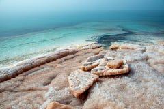 Salt at the Dead Sea beach. Jordan. Royalty Free Stock Photography