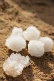 Salt of Dead Sea. Natural salt of Dead Sea on sand Royalty Free Stock Photos