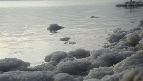 Salt deposits on the banks of the Dead Sea stock video