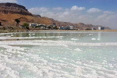 Salt deposits and resort area on the Dead Sea Royalty Free Stock Photography