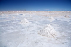 Salt desert with pyramids of salt in Salar de Uyuni Stock Photo