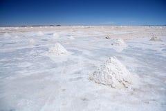 Salt desert with pyramids of salt in Salar de Uyuni Stock Photo