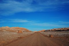 Salt in a desert road in Chile Royalty Free Stock Photos