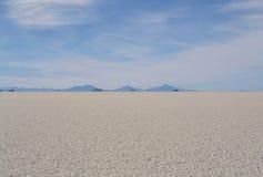 Salt desert, Salar de Uyuni in Bolivia. Salt desert with mountains in the far distance, Salar de Uyuni in Bolivia Stock Images