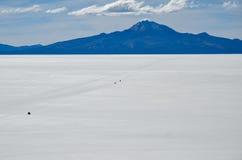 Salt Desert, Uyuni, Bolivia. Cars crossing the Salt Flats Stock Photo