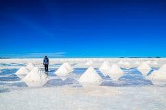 The Salt Desert, Uyuni, Bolivia. Piles of salt to dry in the Bolivian desert Stock Image
