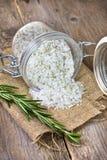 Salt with dry rosemary Stock Photo