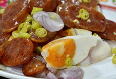 Salt egg and deep-fried Chinese sausage spicy salad Royalty Free Stock Images