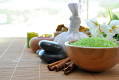 Salt and essential round stones for massages Stock Photography