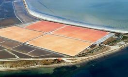Salt evaporation pins. Aerial view of salt evaporation pond next to sea royalty free stock photography