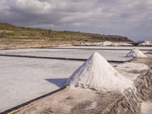 Salt evaporation pond and pile of salt. Coast of la Reunion island Royalty Free Stock Photography