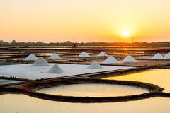 Salt evaporation pond. S, also called salterns or salt pans, are shallow artificial ponds designed to extract salts from sea water or other brines stock photo