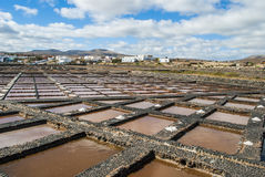 Salt evaporation pond. The seawater or brine is fed into large ponds and water is drawn out through natural evaporation which allows the salt to be subsequently royalty free stock photography