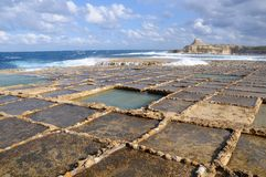 Salt evaporation ponds. Off the coast of Gozo Stock Photo