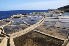 Salt evaporation ponds. Off the coast of Gozo Stock Image