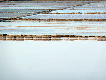 Salt evaporation ponds. Traditional saline on Marsala, Trapani, Sicily, Italy Royalty Free Stock Photo