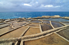 Salt evaporation ponds. Off the coast of Gozo, Malta Stock Photo