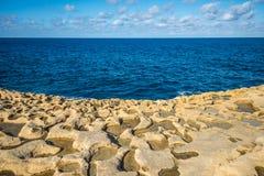 Salt evaporation ponds on Gozo island, Malta Stock Photo