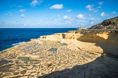 Salt evaporation ponds on Gozo island, Malta.  Royalty Free Stock Photo