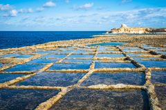 Salt evaporation ponds on Gozo island, Malta.  Royalty Free Stock Images