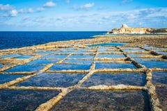 Salt evaporation ponds on Gozo island, Malta Royalty Free Stock Images