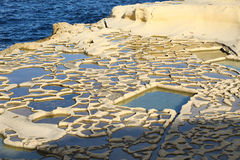 Salt evaporation ponds, Malta. Salt evaporation ponds off the coast of Gozo Stock Images