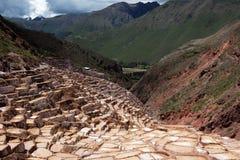 Salt evaporation ponds in Maras in Peru. Salt ponds in Maras in Peru on a sunny day Stock Images